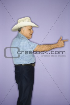 Man wearing cowboy hat.