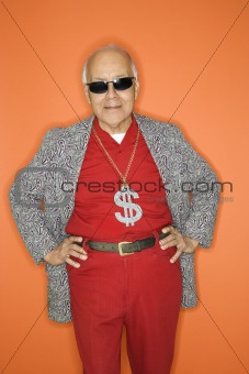 Man wearing money sign necklace.