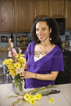 Pregnant mother arranging flowers.