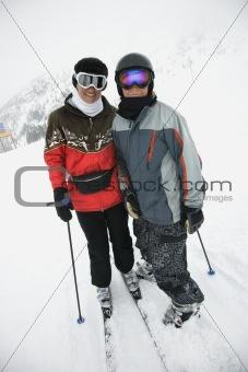 Mom and son at ski slope.