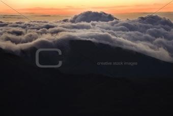 Sunrise over clouds in Haleakala, Maui, Hawaii.
