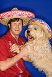 Dog and man wearing  sombreros.