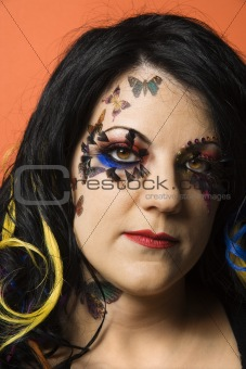 Caucasian woman wearing unique makeup.
