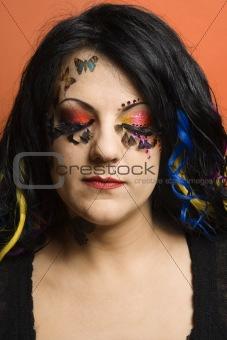 Caucasian woman wearing unique makeup.
