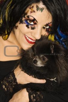 Caucasian woman holding Pomeranian dog.