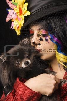 Portrait of unique Caucasian woman with Pomeranian dog.