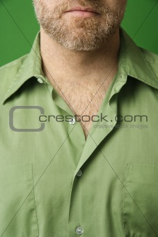 Caucasian man with open collar.
