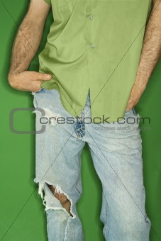 Caucasian man with torn jeans.