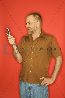 Caucasian man with cellphone.
