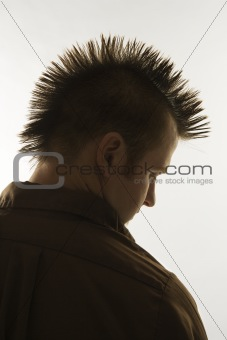 Caucasian man with mohawk.