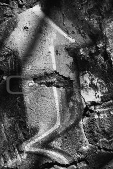 Close-up black and white of graffiti.