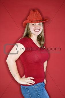 Caucasian female in cowboy hat smiling.