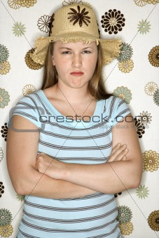 Caucasian female pouting with arms crossed.