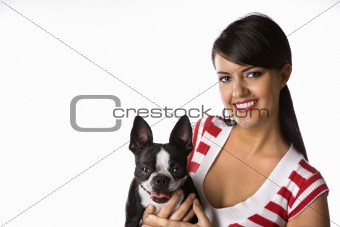 Young Caucasian woman holding Boston Terrier dog.