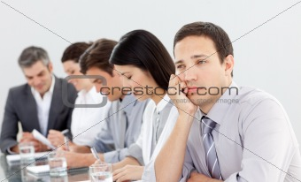 Attractive businessman bored at a presentation