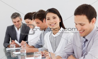 Smiling business partners taking notes in a meeting