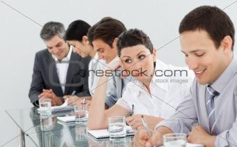 Beautiful businesswoman bored at a presentation