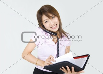 business women with a notepad and phone