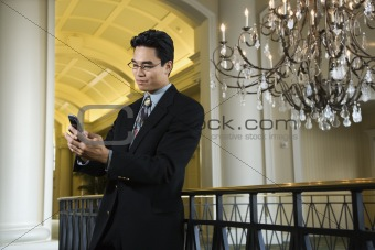 Businessman Checking Messages on Cellphone