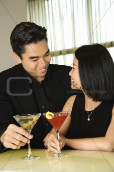 Attractive Young Couple With Cocktails Smiling