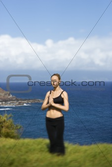 Attractive Young Woman Standing in Meditation