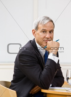 Businessman leaning on table
