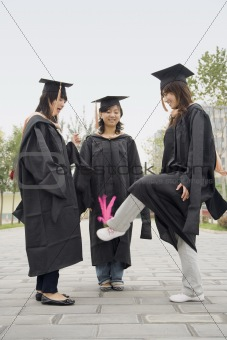 Three Female Graduates Playing Game