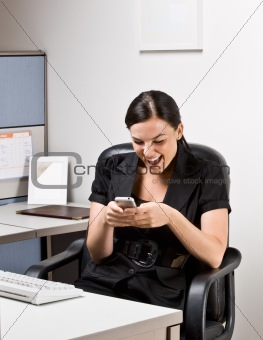 Businesswoman text messaging on cell phone