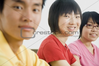 Three Asian People Smiling at Camera