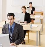 Business people typing on computer