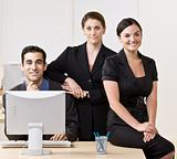 Business people smiling and posing together
