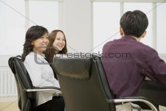 Three People in Meeting