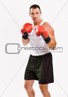 Boxer in boxing gloves training