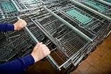 Shopper's Hands Selecting a Shopping Cart