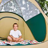 Boy sitting in tent