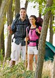 Couple in backpacks hiking