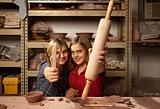 Young girls with tools in clay studio