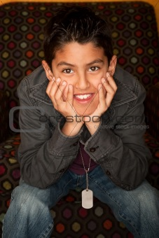Handsome Young Hispanic Seated in Colorful  Chair