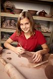 Young girl working in clay studio