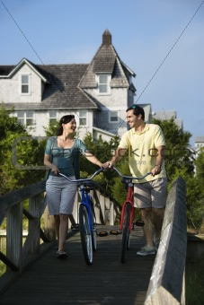 Couple on Bridge with Bicycles