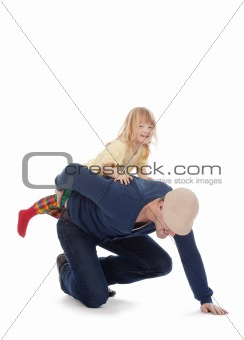 boy with long blond hair riding on fathers back - isolated on white