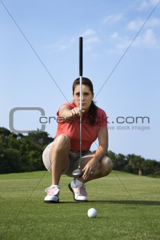 Female Golfer Concentrating