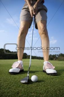 Adult Female Golfing