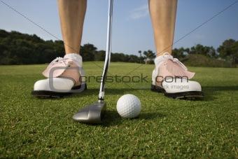 Female Golfer Putting