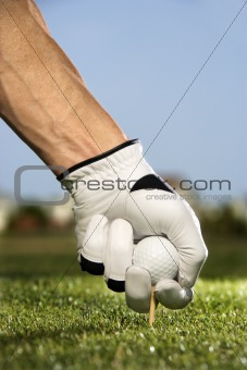 Golfer Placing Tee and Ball