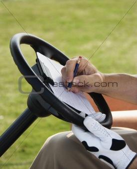 Man Scoring Golf