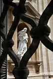 Statue of Saint Teresa of Avila Viewed Through Fence