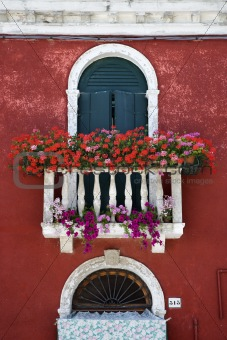 Arched Window with Balcony and Flowers