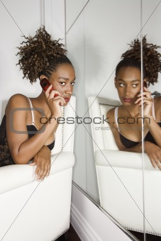 Attractive Young Woman Sitting in Chair