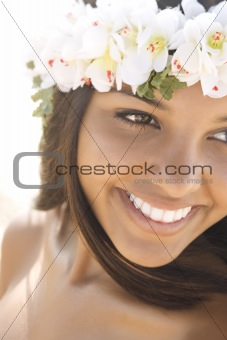 Attractive Young Woman in Lei Smiling